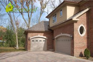 Robincrest house driveway and 3 garages, new homes, Greenleaf Developers Glenview
